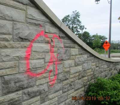 Paint Graffiti On Street Wall Before Power Washing